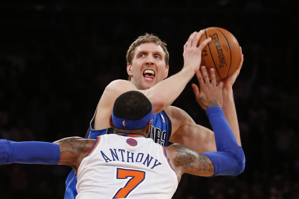 Dallas Mavericks\' Dirk Nowitzki works to get open before shooting the game-winning basket against New York Knicks\' Carmelo Anthony (7) in the final seconds of an NBA basketball game Monday, Feb. 24, 2014, in New York. Dallas won 110-108. (AP Photo/Jason DeCrow)