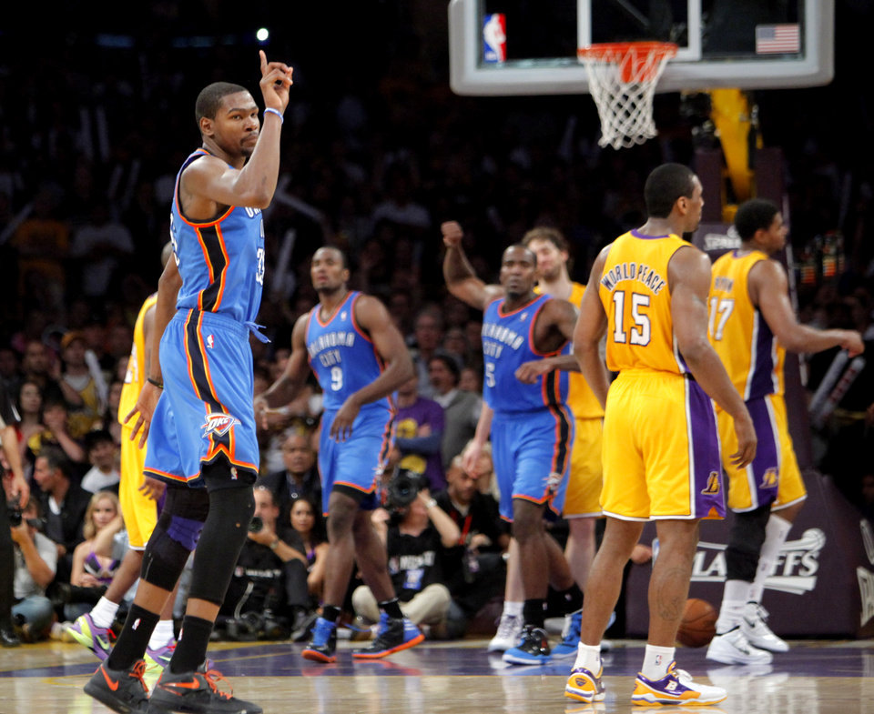 Oklahoma City\'s Kevin Durant (35) celebrates the game winning three-point shot during Game 4 in the second round of the NBA basketball playoffs between the L.A. Lakers and the Oklahoma City Thunder at the Staples Center in Los Angeles, Saturday, May 19, 2012. Oklahoma City won, 103-100. Photo by Nate Billings, The Oklahoman