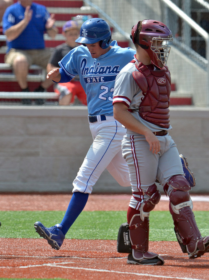 Photo - Indiana State's Landon Curry runs across home plate to score in the team's 8-1 loss to Stanford during an NCAA college baseball tournament regional game Friday, May 30, 2014, in Bloomington, Ind. (AP Photo/Tribune-Star, Joseph C. Garza)