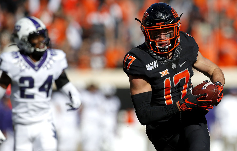 Photo - Oklahoma State's Dillon Stoner (17) runs for a touchdown after a reception in the first quarter during the college football game between the Oklahoma State University Cowboys and the TCU Horned Frogs at Boone Pickens Stadium in Stillwater, Okla.,  Saturday, Nov. 2, 2019. [Sarah Phipps/The Oklahoman]