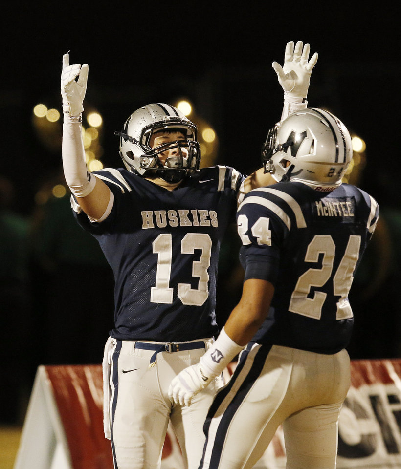 EN#13 Kyle Willis celebrates his touchdown with #24 Ezel McIntee that tied the game 14-14 during the high school football game between Norman North and Edmond North in Edmond at Wantland Stadium Friday, Friday, October 18, 2013.  Photo by Doug Hoke, The Oklahoman