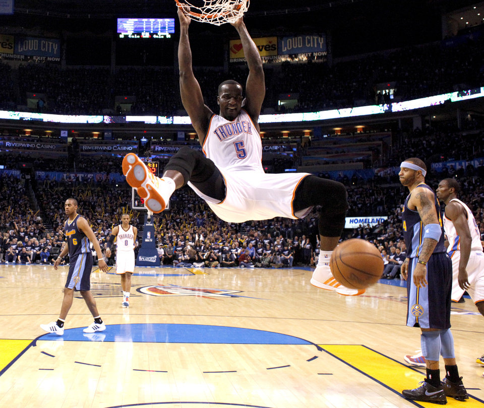 Photo - Oklahoma City's Kendrick Perkins (5) reacts after dunking the ball during the NBA basketball game between the Denver Nuggets and the Oklahoma City Thunder in the first round of the NBA playoffs at the Oklahoma City Arena, Wednesday, April 27, 2011. Photo by Sarah Phipps, The Oklahoman
