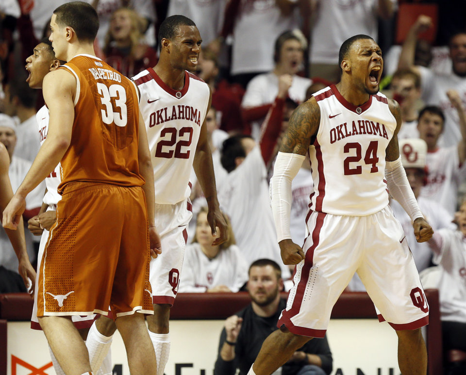 Oklahoma's Romero Osby (24) reacts near Amath M'Baye (22) and Texas' Ioannis Papapetrou (33) after making a basket and being fouled during an NCAA basketball game between Oklahoma and Texas at the Lloyd Noble Center in Norman, Okla., Monday, Jan. 21, 2013. Oklahoma won, 73-67. (AP Photo/The Oklahoman, Nate Billings)
