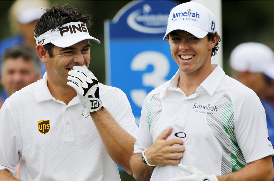 Photo -   Louis Oosthuizen, left, of South Africa, and Rory McIlroy, of Northern Ireland, laugh while waiting to tee off on the third hole during the third round of the Deutsche Bank Championship PGA golf tournament at TPC Boston in Norton, Mass., Sunday, Sept., 2, 2012. (AP Photo/Michael Dwyer)