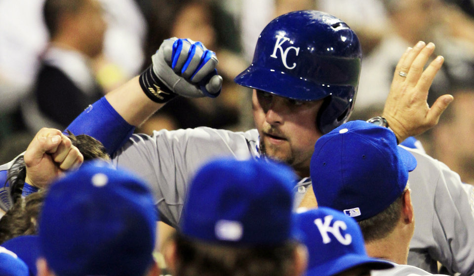 Photo -   Kansas City Royals' Billy Butler celebrates with teammates after hitting a home run against the Chicago White during the seventh inning of a baseball game, Monday, Aug. 6, 2012, in Chicago. (AP Photo/John Smierciak)