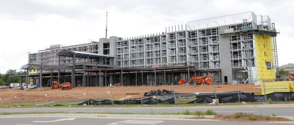 Photo -  An Embassy Suites is being built at NE 7 and Phillips Avenue in Oklahoma City Tuesday. Photo by Paul B. Southerland, The Oklahoman   PAUL B. SOUTHERLAND