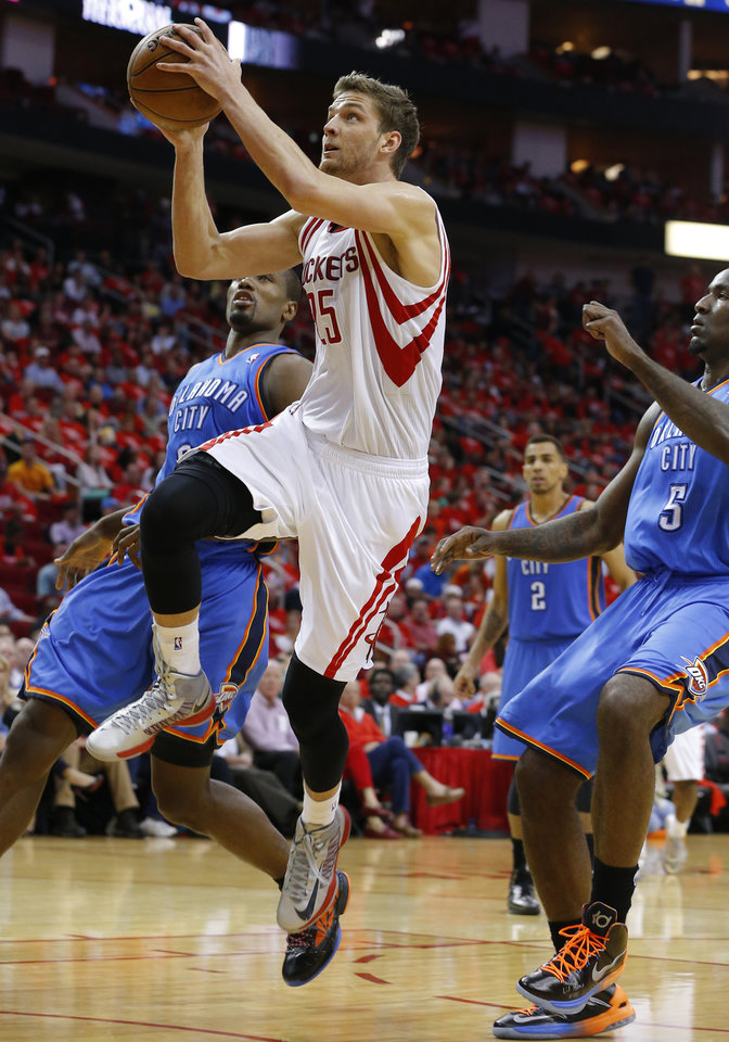 Houston's Chandler Parsons (25) goes to the basket past Oklahoma City's Serge Ibaka (9) and Kendrick Perkins (5) during Game 4 in the first round of the NBA playoffs between the Oklahoma City Thunder and the Houston Rockets at the Toyota Center in Houston, Texas,Sunday, April 29, 2013. Oklahoma City lost 105-103. Photo by Bryan Terry, The Oklahoman