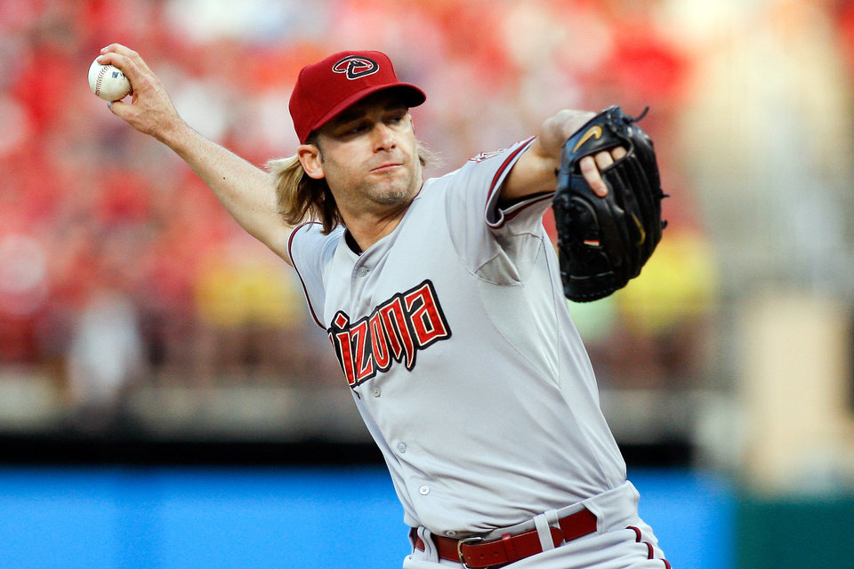 Photo - Arizona Diamondbacks starting pitcher Bronson Arroyo  throws during the first inning of a baseball game against the St. Louis Cardinals Tuesday, May 20, 2014, in St. Louis. (AP Photo/Scott Kane)