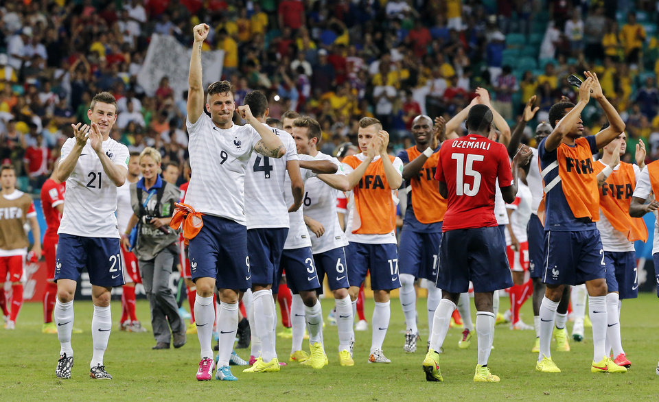 Photo - French players celebrate after the group E World Cup soccer match between Switzerland and France at the Arena Fonte Nova in Salvador, Brazil, Friday, June 20, 2014.  The match ended in a 5-2 win for France. (AP Photo/David Vincent)