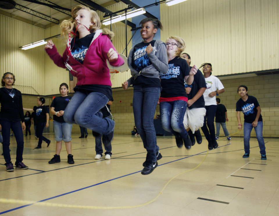 Photo - Girls jump rope during PE class at Webster Middle School in Oklahoma City, OK, Friday, May 4, 2012. This is for a story about the life of a middle school.  By Paul Hellstern, The Oklahoman
