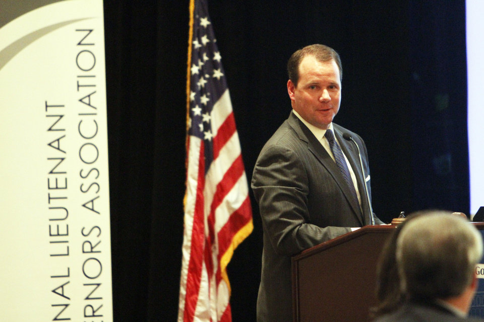 Photo - NLGA Chair-Elect Lt. Governor of Oklahoma, Todd Lamb, gives a welcome speech and introduces Governor Mary Fallin at the 2013 National Lieutenant Governors Association Annual Meeting on Wednesday. Photo by Aliki Dyer, The Oklahoman  Aliki Dyer - The Oklahoman
