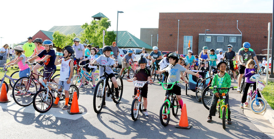 Photo -   Above:  Young bicyclists join the city's Family Bike Ride at J.L. Mitch Park as part of National Bike Month in May. [The Oklahoman Archives]