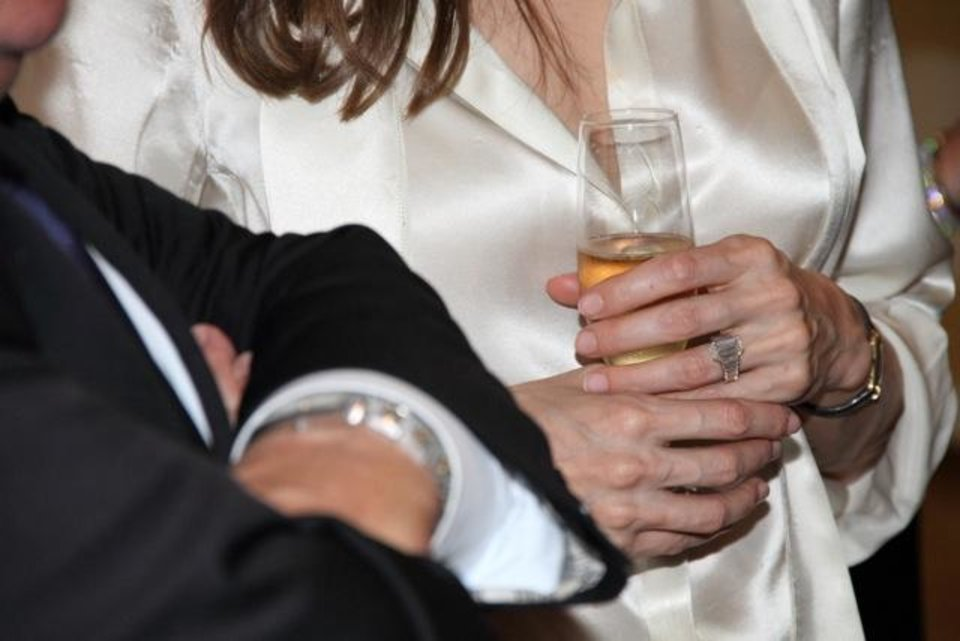 Photo -   Actress Angelina Jolie, sports an engagement ring as she and Brad Pitt, view works from the Chinese collection at the The Los Angeles County Museum of Art, in Los Angeles Thursday April 12, 2012. Pitt's manager Cynthia Pett-Dante confirmed their engagement on Friday. Robert Procop confirmed that the ring was created by him, in collaboration with Brad Pitt, for Angelina Jolie. (AP Photo/Robert Procop, The Communications Group)