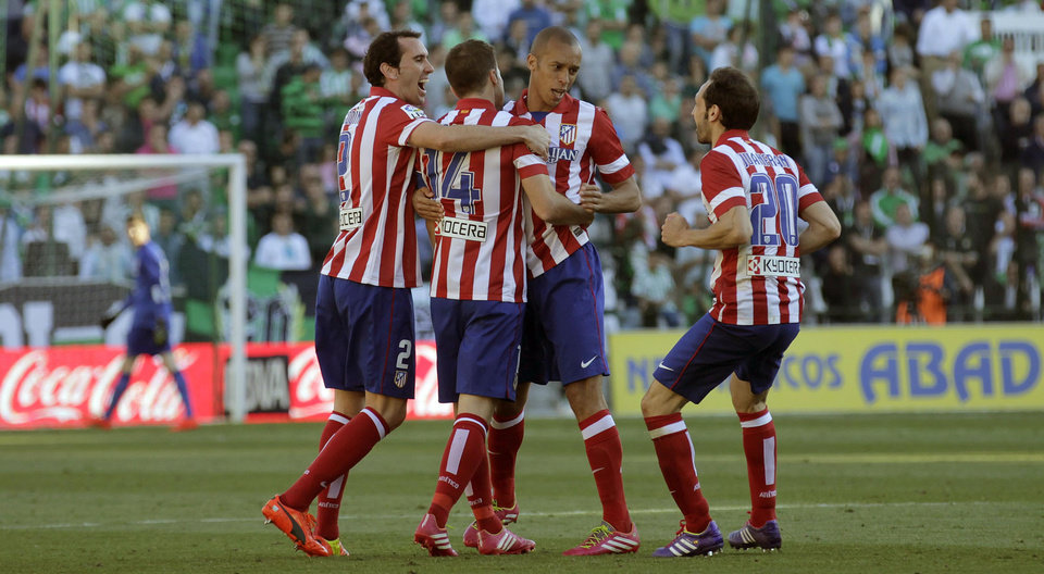 Photo - Atletico de Madrid's Gabi Fernandez, second left, celebrates with teammates after scoring against Betis during their La Liga soccer match at the Benito Villamarin stadium, in Seville, Spain on Sunday, March 23, 2014. (AP Photo/Angel Fernandez)
