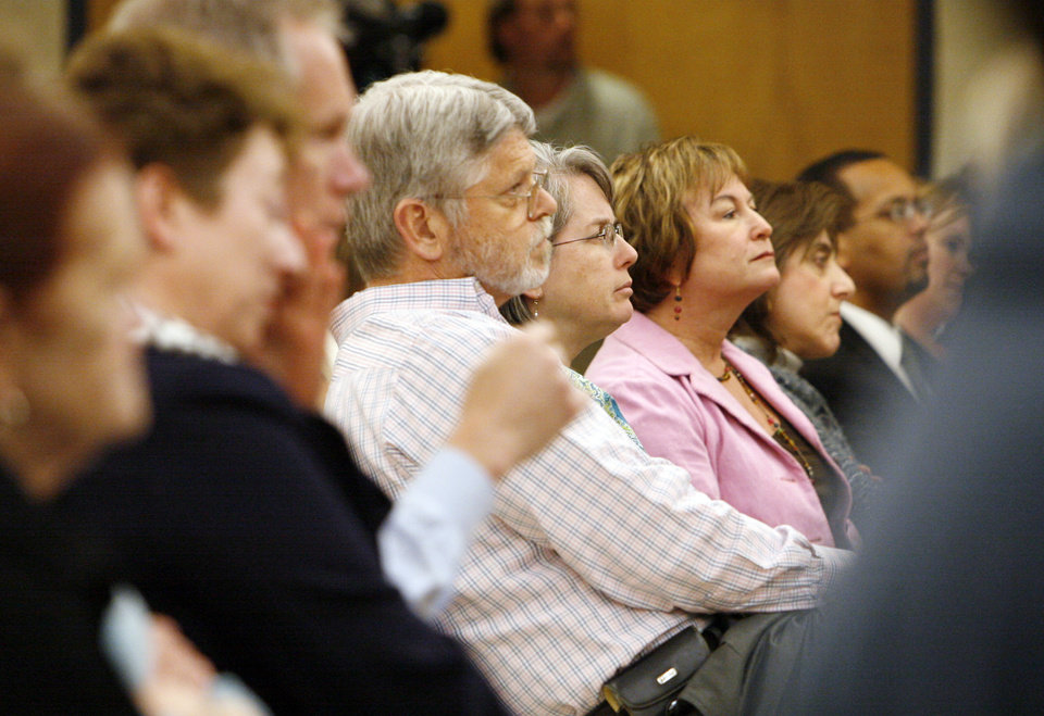 Photo - Parents and concerned citizens listen to a speaker during the Edmond Board of Education's Public Forum concerning the district's proposed new drug testing policy, at Edmond North High School in Edmond, Okla., February 9, 2009. BY NATE BILLINGS, THE OKLAHOMAN