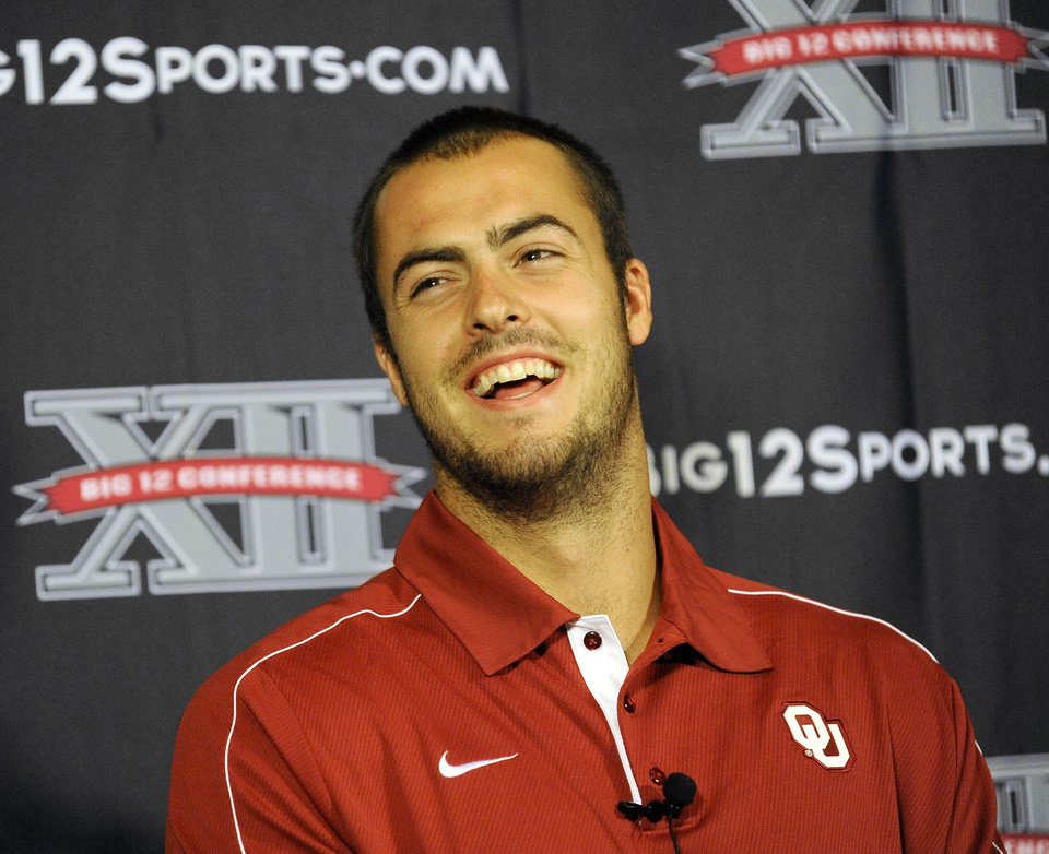 Photo - Oklahoma quarterback Landry Jones laughs at a question at NCAA college football Big 12 Media Days, Monday, July 23, 2012, in Dallas. (AP Photo/Matt Strasen) ORG XMIT: TXMS122