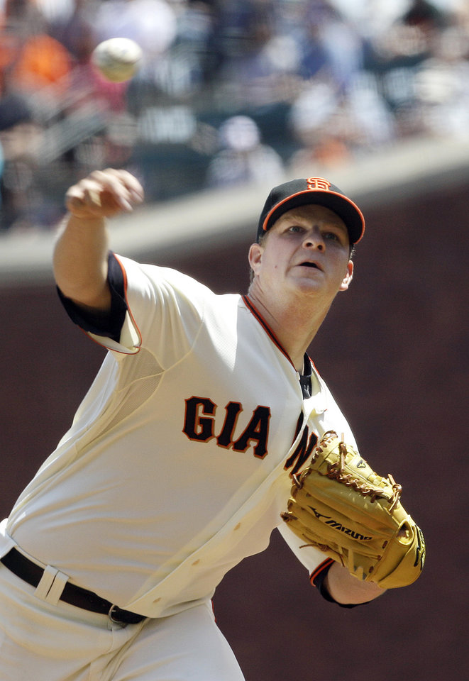 Photo -   San Francisco Giants pitcher Matt Cain (18) delivers against the Milwaukee Brewers during the first inning of a baseball game in San Francisco, Sunday, May 6, 2012. (AP Photo/Jeff Chiu)