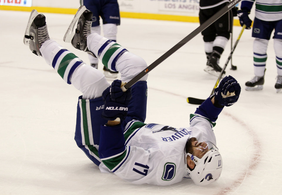 Photo - Vancouver Canucks center Ryan Kesler (17) celebrates after scoring against the Los Angeles Kings during the first period of an NHL hockey game on Saturday, Jan. 4, 2014, in Los Angeles. (AP Photo/Alex Gallardo)