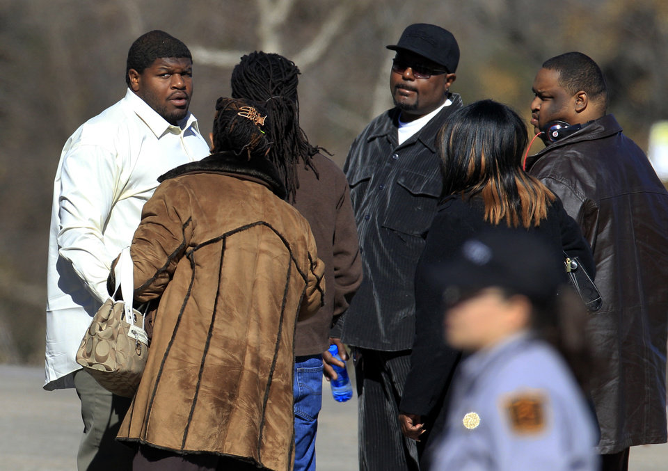 ADDS ID OF STACEY JACKSON, MOTHER OF JERRY BROWN - Dallas Cowboys football player Josh Brent, left, arrives with Stacey Jackson, second from left, mother of Cowboys player Jerry Brown, and other unknown persons at Oak Cliff Bible Fellowship for a memorial service for Brown, Tuesday, Dec. 11, 2012, in Dallas. Brown died in a suspected drunken-driving accident on Saturday. Brent was the driver and is charged with intoxication manslaughter. (AP Photo/LM Otero)