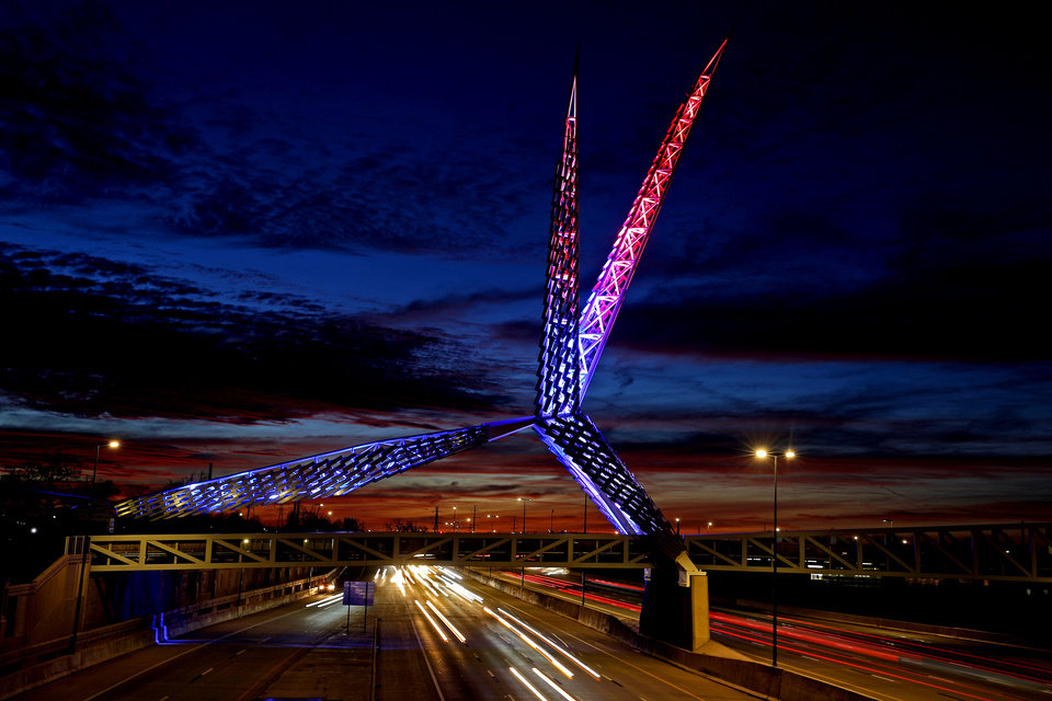 Photo - The Skydance Bridge is lit in red, white and blue on President Jospeh Biden's inauguration day in celebration of the United States of America in Oklahoma City, Wednesday, Jan. 20, 2021. [Bryan Terry/The Oklahoman]