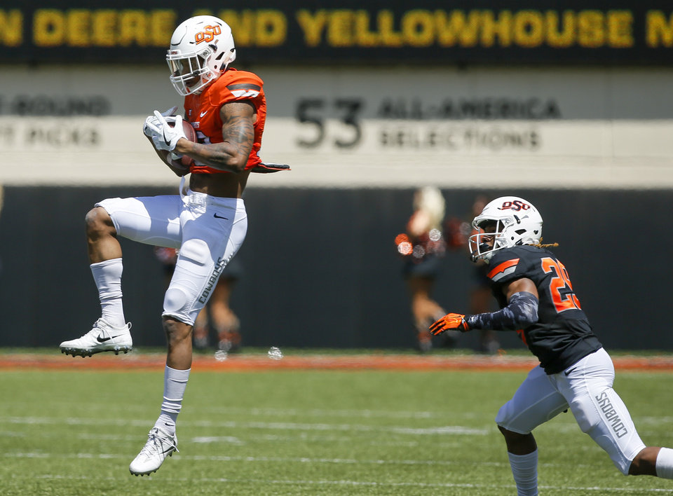 Photo - Tyron Johnson (13) makes a catch in front of Bryce Brown (29) during the spring football game for the Oklahoma State Cowboys (OSU) at Boone Pickens Stadium in Stillwater, Okla., Saturday, April 28, 2018. Photo by Nate Billings, The Oklahoman