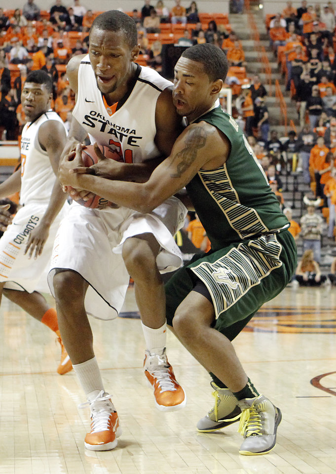 Oklahoma State \'s Kamari Murphy (21) fights for the ball with South Florida Bulls\' Anthony Collins (11) during the college basketball game between Oklahoma State University (OSU) and the University of South Florida (USF) on Wednesday , Dec. 5, 2012, in Stillwater, Okla. Photo by Chris Landsberger, The Oklahoman