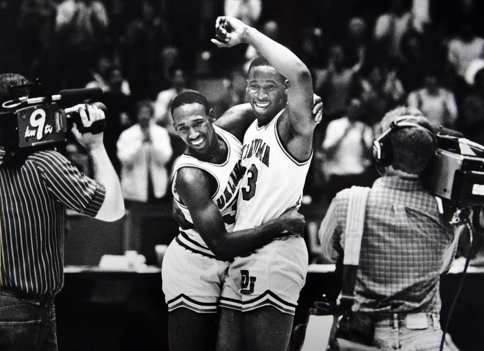 Former OU basketball player Wayman Tisdale. As the cameras bring it all in focus, Wayman Tisdale ( right) gets a congratulatory hug from teammate Darryl Kennedy after breaking the Big Eight career scoring record Saturday. Staff photo by Doug Hoke. Photo taken 1/12/1985, Photo published 1/13/1985 in The Daily Oklahoman. ORG XMIT: KOD