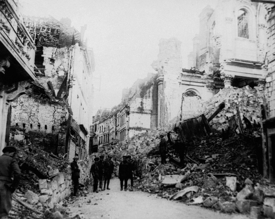 Photo - FILE - In this August 1916 file photo, Gen. Sam Hughes and an unidentified group look at ruins in Arras, France during World War I. Approximately 45 Tour de France riders lost their lives during the 1914-1918 war. The 2014 Tour de France will ride along key points of the Western Front, including Ypres, Belgium and Arras, France to pay homage to all soldiers who died in the war. (AP Photo, File)