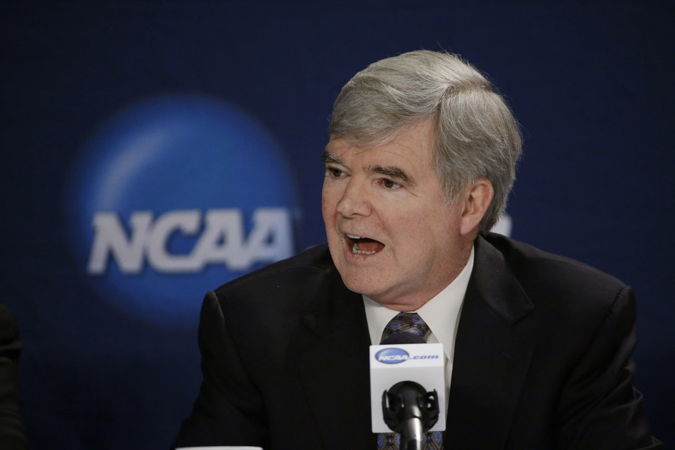 Photo - FILE - In this April 6, 2014, file phot, NCAA President Mark Emmert answers a question at a news conference in Arlington, Texas. Testifying in a landmark antitrust lawsuit filed against his organization, Emmert said Thursday, June 19, 2014, he believes there is a clear difference between the proposal to pay athletes a few thousand more dollars a year and giving them the equivalent of a salary. Emmert's testimony came in a much-anticipated appearance as the NCAA tries to convince U.S. District Judge Claudia Wilken that its system of so-called amateurism is not anti-competitive and is the best model for regulating college sports. (AP Photo/David J. Phillip, File)