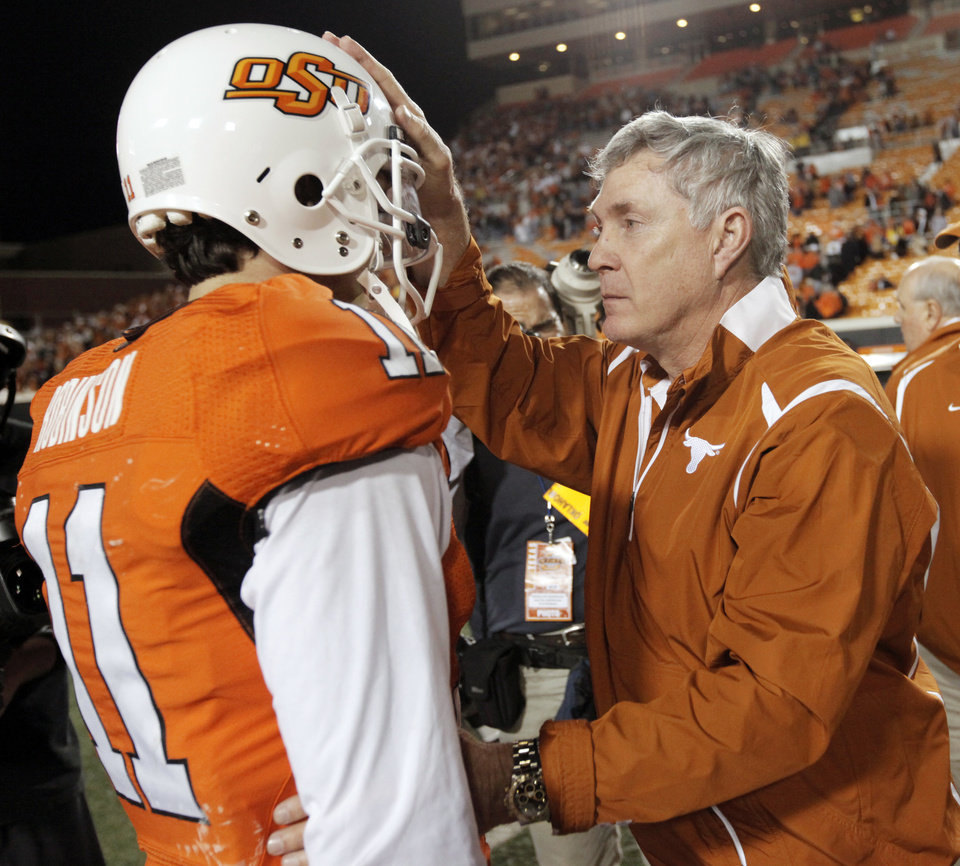 Photo - Texas head coach Mack Brown pats OSU quarterback Zac Robsinson (11) on the head after the two talked following the college football game between the Oklahoma State University Cowboys (OSU) and the University of Texas Longhorns (UT) at Boone Pickens Stadium in Stillwater, Okla., Saturday, Oct. 31, 2009. Texas won, 41-14. Photo by Nate Billings, The Oklahoman