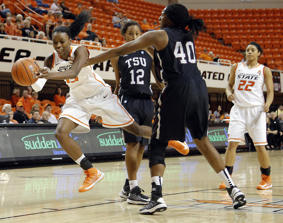 Oklahoma State 's Toni Young (15) is tripped up by Texas Southern 's Crystal Anyiam (40) during the women's college basketball game between Oklahoma State University and Texas Southern University on Saturday, Dec. 1, 2012, in Stillwater, Okla.   Photo by Chris Landsberger, The Oklahoman