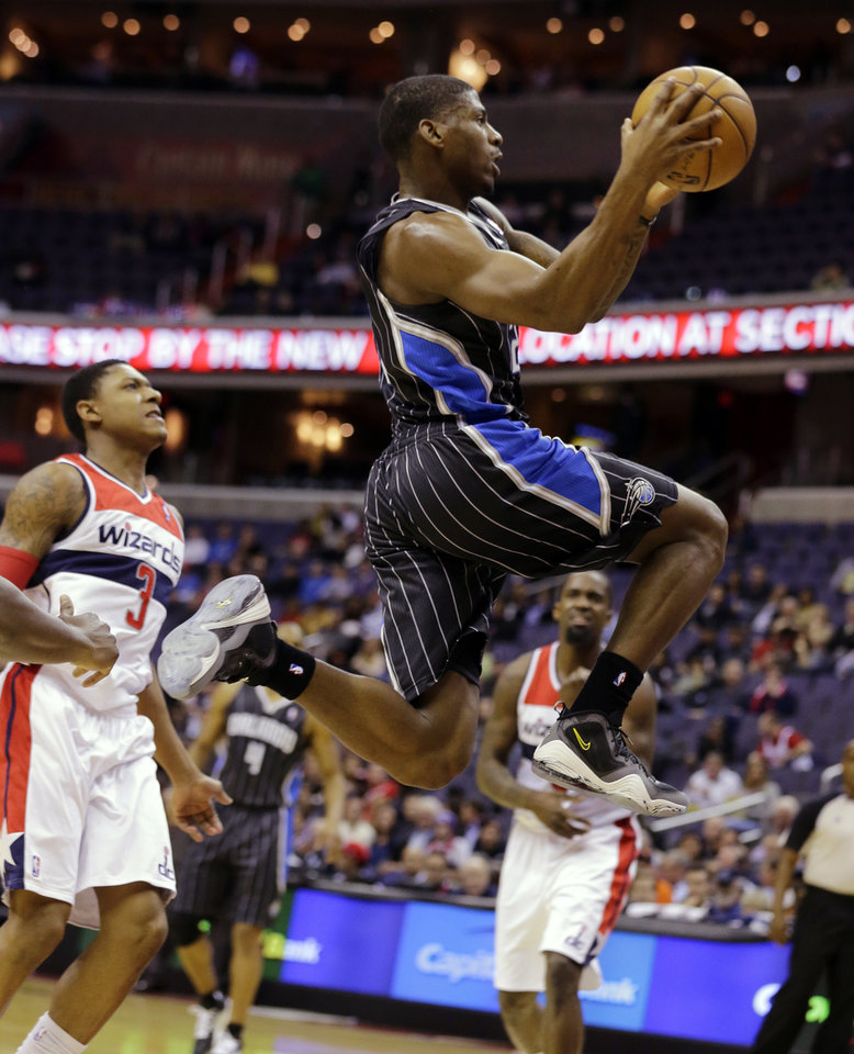 Orlando Magic guard DeQuan Jones (20) goes up for a shot as he gets past Washington Wizards guard Bradley Beal (3) in the first half of an NBA basketball game Monday, Jan. 14, 2013 in Washington. (AP Photo/Alex Brandon)