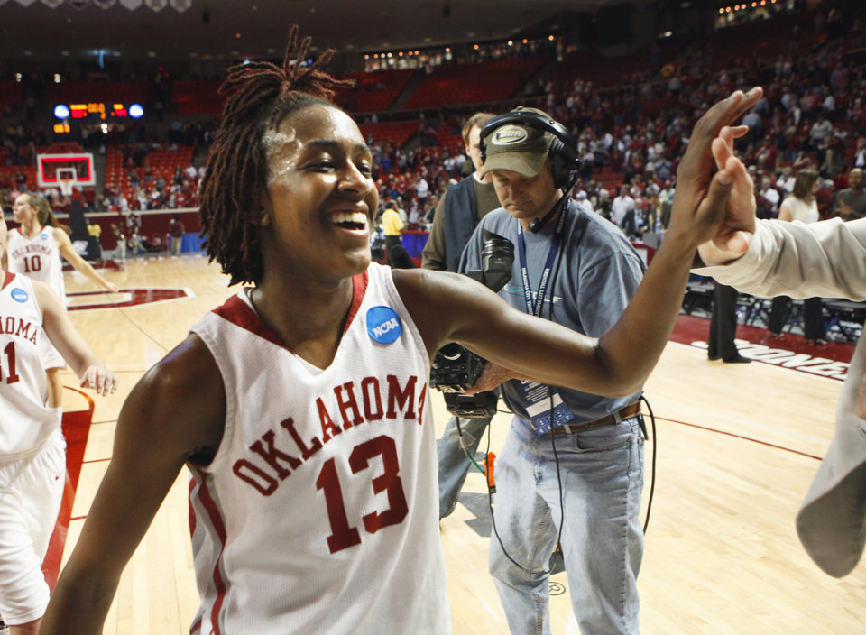 Photo - Danielle Robinson leaves the court after the Sooners defeated Arkansas Little Rock 60-44  at Lloyd Noble Center on Monday.    Photo by Steve Sisney, The Oklahoman