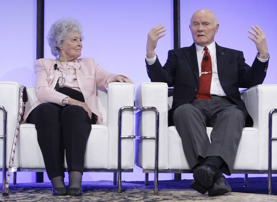 Sen. John Glenn, right, with his wife Annie, answers questions during a celebration dinner honoring his legacy on the 50th anniversary of his historic flight aboard Friendship 7 Monday, Feb. 20, 2012, in Columbus, Ohio. Glenn was the first American to orbit Earth, piloting Friendship 7 around it three times in 1962, and also became the oldest person in space, at age 77, by orbiting Earth with six astronauts aboard shuttle Discovery in 1998. (AP Photo/Jay LaPrete)
