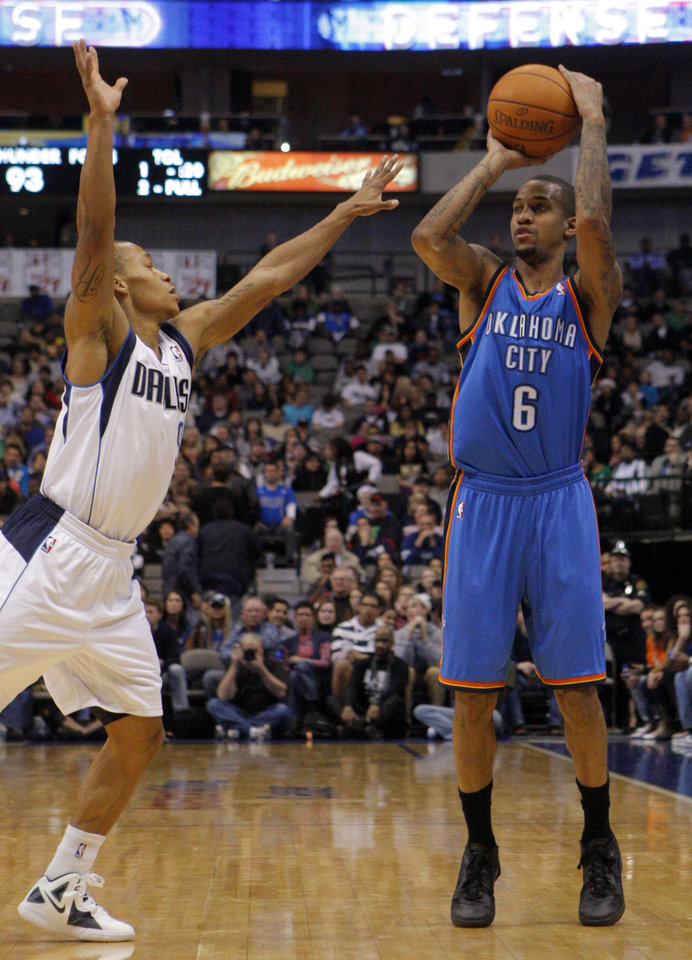 Oklahoma City's Eric Maynor (6) shoots over Dallas' Jerome Randle during the pre season NBA game between the Dallas Mavericks and the Oklahoma City Thunder at the American Airlines Center in Dallas, Sunday, Dec. 18, 2011. Photo by Sarah Phipps, The Oklahoman