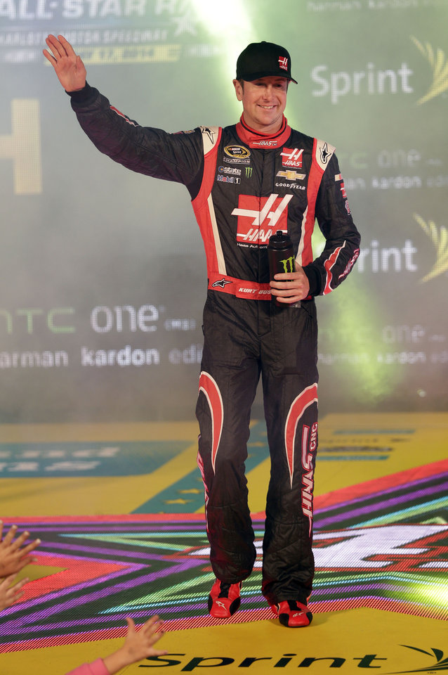 Photo - Kurt Busch is introduced before the NASCAR Sprint All-Star auto race at Charlotte Motor Speedway in Concord, N.C., Saturday, May 17, 2014. (AP Photo/Chuck Burton)