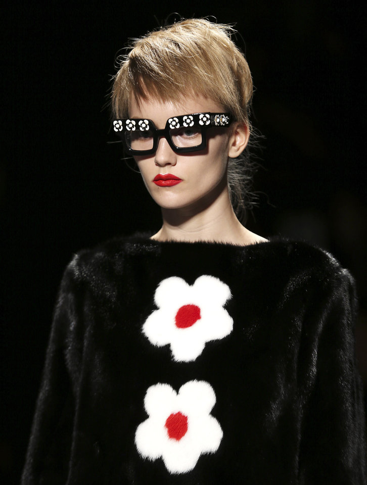 Photo -   FILE - This Sept. 20, 2012 file photo shows a model wearing a creation part of the Prada Women's Spring-Summer 2013 fashion collection, during the fashion week in Milan, Italy. Tweaking your makeup routine is something you probably could do today because it's changing how you wear the products more than a change in products themselves, says Linda Wells, editor in chief of Allure. (AP Photo/Antonio Calanni, file)