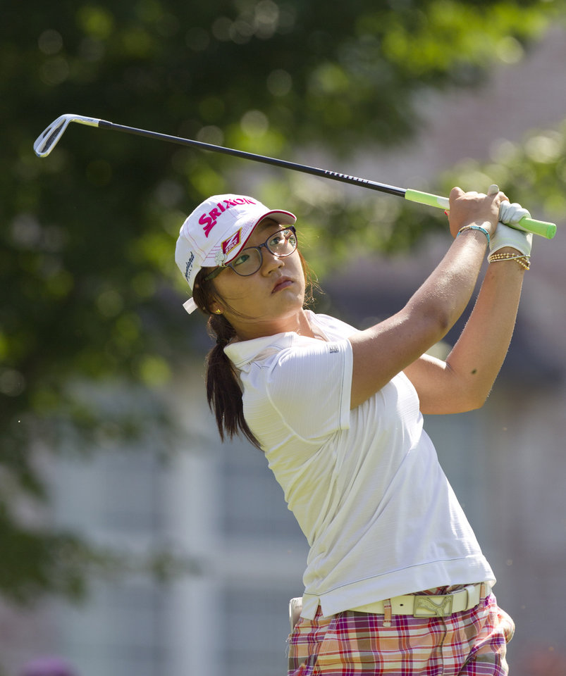 Photo - Lydia Ko, of New Zealand, watches her ball from the 16th tee box during the final round of the LPGA NW Arkansas Championship golf tournament on Sunday, June 23, 2013, in Rogers, Ark. (AP Photo/Beth Hall)