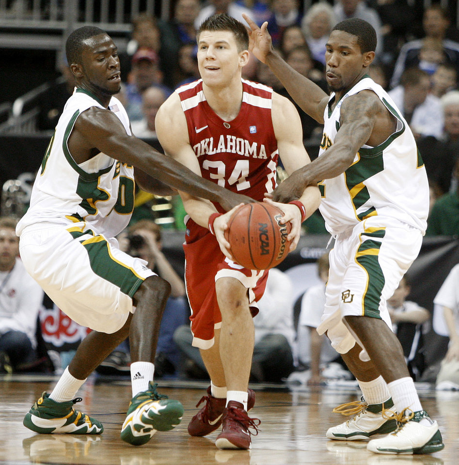OU's Cade Davis tries to get past Baylor's Stargell Love, left, and A.J. Watson during the college basketball Big 12 Championship tournament game between the University of Oklahoma and Baylor in Kansas City, Mo., Wednesday, March 9, 2011.  Photo by Bryan Terry, The Oklahoman