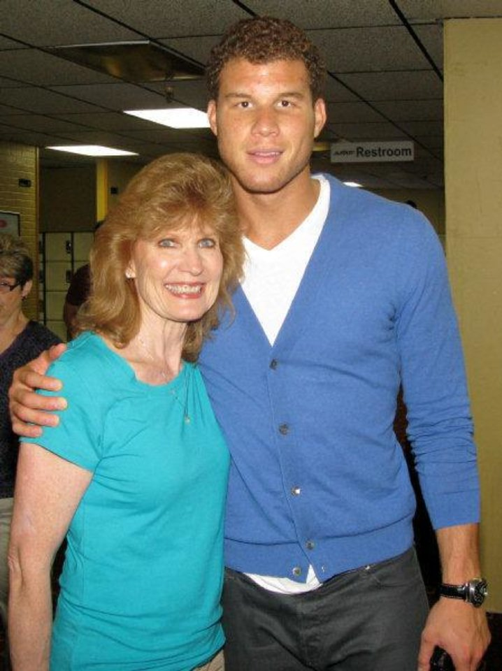 Photo - Blake Griffin hugs his mom, Gail Griffin, during the Bowling Down Cancer Charity Event that raised more than $100,000 for scholarships and cancer research in honor of his friend Wilson Holloway, who died of Hodgkin's Lymphoma earlier this year. PHOTO BY LILLIE-BETH BRINKMAN, THE OKLAHOMAN