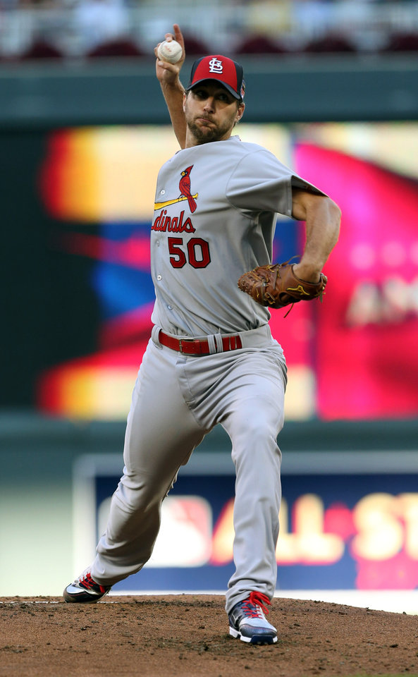 Photo - National League starting pitcher Adam Wainwright, of the St. Louis Cardinals, throws during the first inning of the MLB All-Star baseball game, Tuesday, July 15, 2014, in Minneapolis. (AP Photo/Jim Mone)