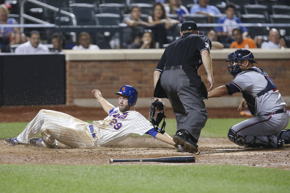 Photo - New York Mets' Eric Campbell (29) is tagged out at home plate by Atlanta Braves catcher Gerald Laird, right, in the ninth inning of a baseball game, Wednesday, Aug. 27, 2014, in New York. The Braves won 3-2. (AP Photo/John Minchillo)