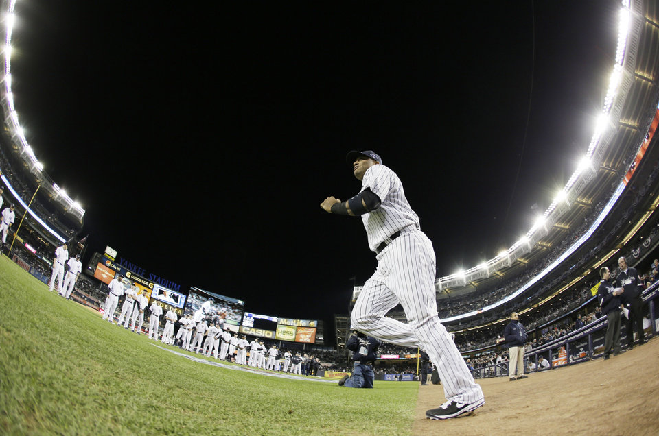 Photo -   In this photo shot with a fisheye lens, New York Yankees' Robinson Cano runs onto the field for ceremonies before Game 1 of the American League championship series against the Detroit Tigers on Saturday, Oct. 13, 2012, in New York. (AP Photo/Matt Slocum)