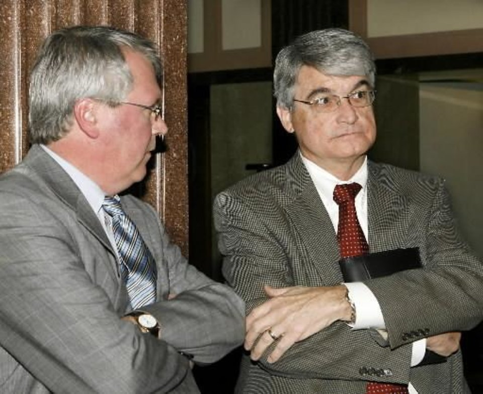 George Stevens, right, and another man wait in the 7th floor hallway following a hearing in an Oklahoma County courtroom Monday, Feb. 23, 2009. Judge ordered members who had been removed by Larry Jones from  Feed the  Children board of directors be temporarily reinstated. BY JIM BECKEL