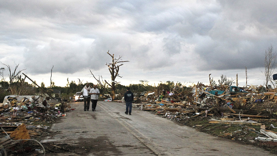Photo - Residents search through what is left of their homes after a tornado hit Pleasant Grove just west of downtown Birmingham a day earlier, on Thursday, April 28, 2011, in Birmingham, Ala. (AP Photo/Butch Dill)
