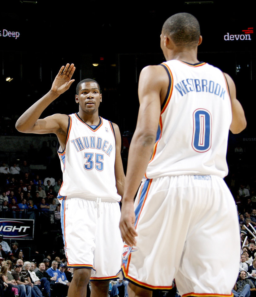 Photo - CELEBRATE / CELEBRATION: Oklahoma City's Kevin Durant celebrates with Russell Westbrook during the NBA basketball game between the Oklahoma City Thunder and the Utah Jazz at the Ford Center in Oklahoma City, Wednesday, Jan. 14, 2008.  PHOTO BY BRYAN TERRY, THE OKLAHOMAN ORG XMIT: KOD