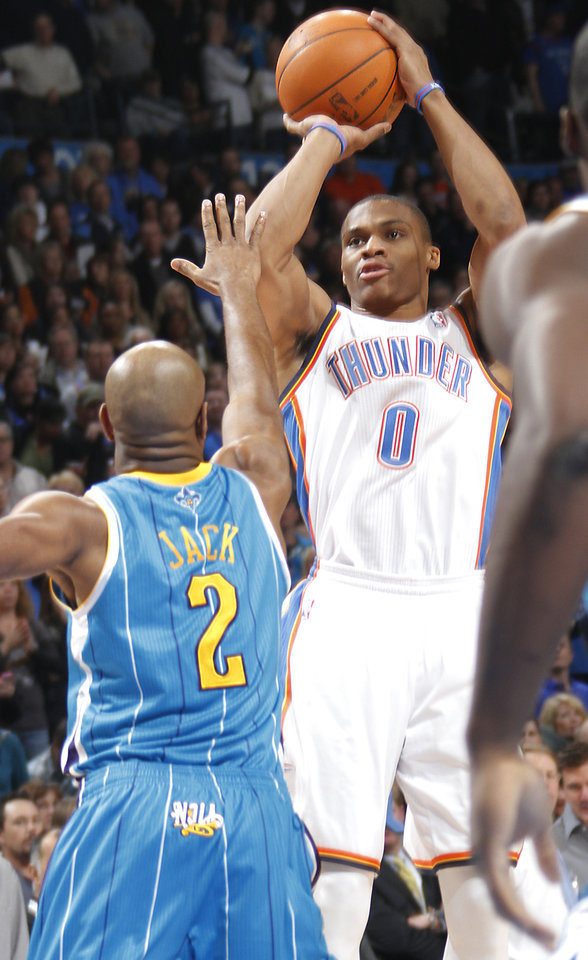 Oklahoma City Thunder point guard Russell Westbrook (0) shoots the ball over New Orleans Hornets point guard Jarrett Jack (2) during the NBA basketball game between the Oklahoma City Thunder and the New Orleans Hornets at the Chesapeake Energy Arena on Wednesday, Jan. 25, 2012, in Oklahoma City, Okla. Photo by Chris Landsberger, The Oklahoman