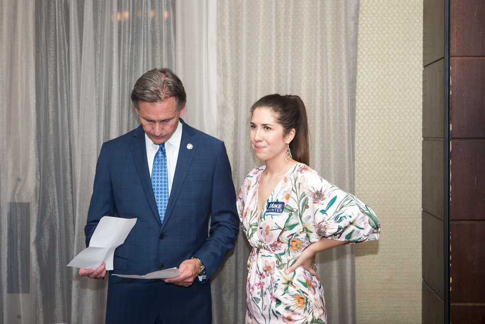Photo - Attorney General Mike Hunter stands with his daughter-in-law Rachael Hunter as he goes through his notes for a speech at the Renaissance Waterford Oklahoma City Hotel in Oklahoma City, Tuesday, June 26, 2018. Photo by Anya Magnuson, The Oklahoman