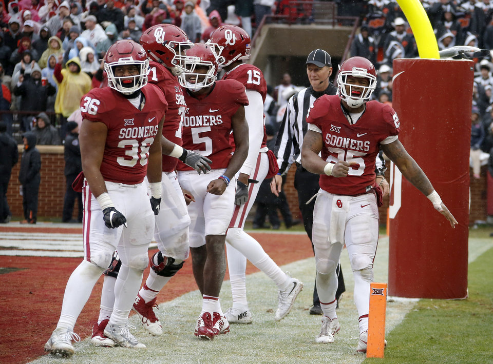 Photo - Oklahoma's Joe Mixon (25) celebrates after  touchdown late in the fourth quarter of the Bedlam college football game between the Oklahoma Sooners (OU) and the Oklahoma State Cowboys (OSU) at Gaylord Family - Oklahoma Memorial Stadium in Norman, Okla., Saturday, Dec. 3, 2016. Oklahoma won 38-20. Photo by Bryan Terry, The Oklahoman