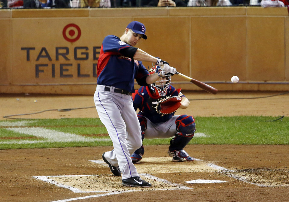 Photo - National League's Justin Morneau, of the Colorado Rockies, hits during the MLB All-Star baseball Home Run Derby, Monday, July 14, 2014, in Minneapolis. (AP Photo/Paul Sancya)